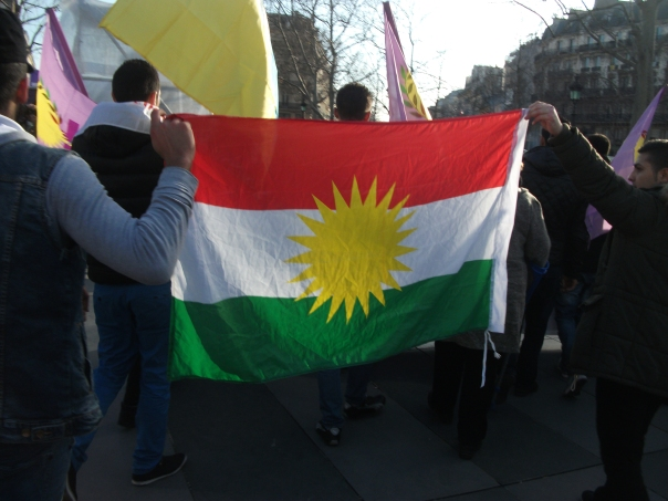 The flag of the Kurdish people, a people without a nation, a people without a land, to whom the promises of history ring hollow today more than they ever have. (C) Bernard J. Henry/AWC