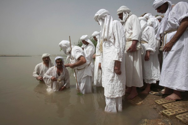 Sabean Mandeans perform baptisms for the faithful, in Iraq's Tigris River. (C) The Washington Post