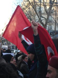 A Tunisian demonstrator in Paris, France, as the Tunisian community there celebrated the first anniversary of the revolution on January 14, 2012. (C) Bernard J. Henry/AWC