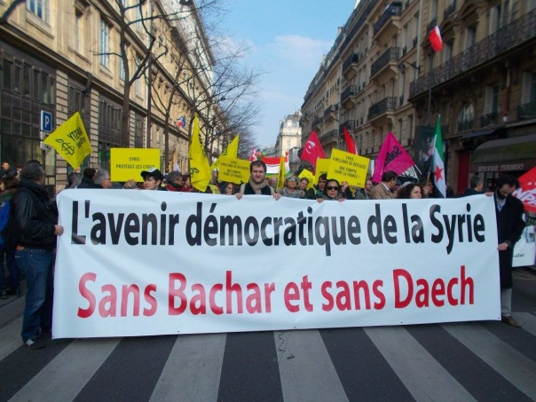 "Syrian demonstrators in Paris, France, vowing for ""a democratic future"" in Syria ""without [Syrian President] Bashar [al-Assad] and without Daesh [ISIS]"". (C) AWC/Bernard J. Henry"